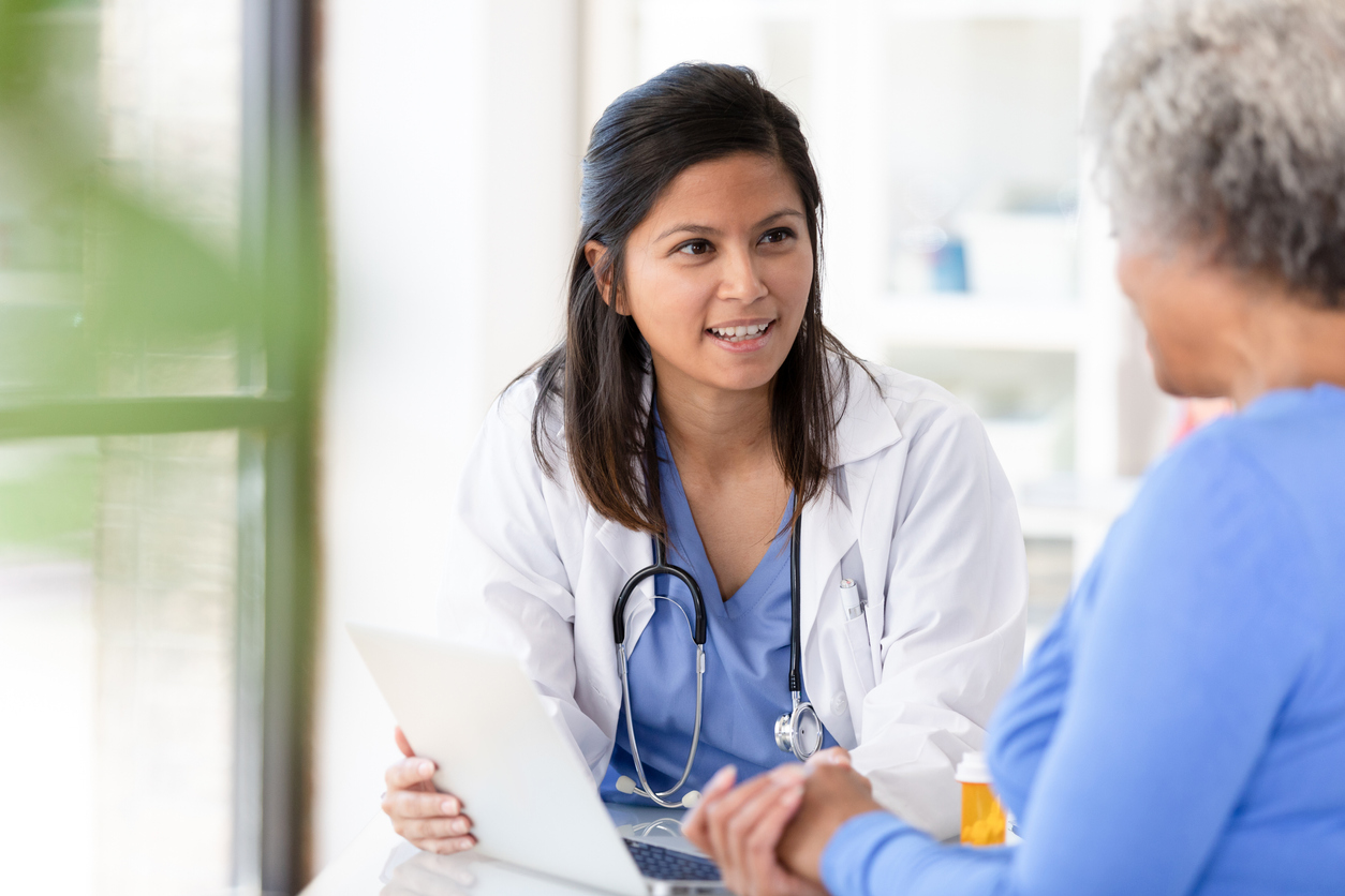 doctor and patient talking medication decisions